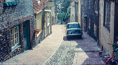 Lewes (M C Smith) Tags: cobbles shops road hill trees green bicycle baskets houses car ford signs lewes windows roses
