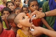Children get polio drops at the Islamia School polio booth in Bada Bazaar area of Mainpuri...UNICEF India/2010/Gurinder Osan.. (unicefindia) Tags: 1to5yearsold diseaseprevention girl grouppeople india poliomyelitis