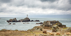 The bunker and the lighthouse (Rob McC) Tags: bunker wwii ww2 militaria coast coastline shore lighthouse corbiere jersey seascape sea ocean landscape hdr cloudy