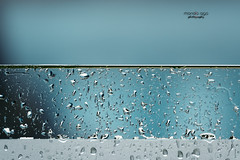 rainy weather (mariola aga) Tags: balcony glass rain rainyweather closeup blue turquoise hue bokeh water raindrops art abstract puntacana vacation saariysqualitypictures thegalaxy