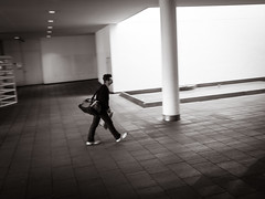 chin.forward (grizzleur) Tags: street streetphotography candid candidstreetphotography stride chin chinup guy dude man slant olympus omd olympusomdem5mkii olympusm17mmf18 omdstreetphotography bw mono monochrome urban city space motionblur pan panning