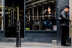 Lunch in East London (The Ultimate Photographer) Tags: london uk england eastlondon bricklane shoreditch friday lunch takeaway chinese food reflection window shop shopping architecture lady deliciousfood blue nosmoking sign darkshot jeans fashion darkhair girl lost mind soul thinking think olympus em1 omd street streephotography ultimatephotographer