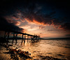 Darkness Falls on the Jetty   [Explored] (RonnieLMills) Tags: wooden jetty pier silhouette sunset reflections moody skies dark clouds kinnegar holywood county down sun beach sky water belfast lough explore explored 14517 13