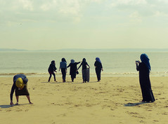 Under wraps (Andy WXx2009) Tags: beach seascape seaside landscape seashore sea resort horizon outdoors people burka muslims women religion group girls barryisland wales europe sand water femme shoreline holiday bristolchannel