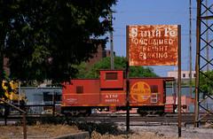 Topeka's Unclaimed Freight Building (Jeff Carlson_82) Tags: internationalcarcompany ce8 caboose waycar 999714 atsf santafe unclaimedfreight sign building bnsf burlingtonnorthernsantafe shovingplatform train railfan railroad railway topeka ks kansas