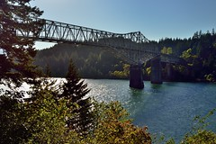 Bridge of the Gods Crossing the Columbia River (thor_mark ) Tags: beams blueskies bridge bridgecolumns bridgecrossing bridgestructure bridgeofthegods capturenx2edited colorefexpro columbiariver columbiarivergorge columbiarivergorgenationalscenicarea day7 girders hillside hillsideoftrees historiccolumbiariverhighway historiccolumbiariverhighwayscenicbyway lookingwest miscellaneous nikond800e portfolio project365 river steeltrusscantileverbridge travel trees triptomountrainierandcolumbiarivergorge trusses usroute30 cascadelocks or unitedstates absolutelystunningscapes