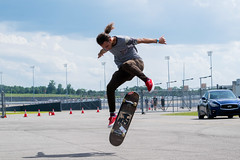 Drake Skating (NamelessPhotographs) Tags: skate skateboarding trick cool snap shot movement capture flip hardflip form nikon outdoor motion flipping speed jump air style fun sport hobby active spons sky blue red board wood