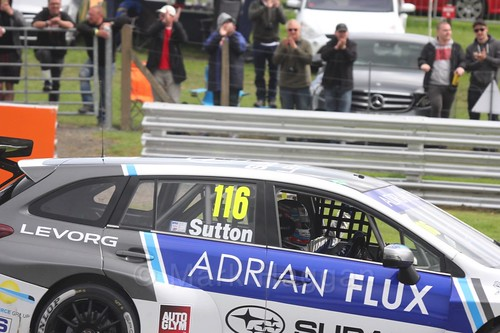 Ashley Sutton celebrates after winning the second BTCC race at Oulton Park, May 2017