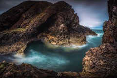 Sheltered Hideout (Augmented Reality Images (Getty Contributor)) Tags: canon cliffs clouds coastline colours landscape leefilters littlestopper longexposure morayfirth portknockie rocks scotland water waves