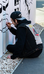 Concertating (Jocey K) Tags: cbd newzealand christchurch nikond750 streetart artist mural artwork person shippingcontainer brush building restartmall words