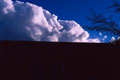 velvia clouds I (Tomás Harrison Fotos) Tags: slidefilm landscape silverfastaistudio8 manualfocus film clouds rvp50 velvia e6 ice availablelight minoltax570 pacificimageelectronicsprimefilmxa nm prime santafe analog fujichromervp50 austin tx usa mdrokkorx50mmf12