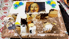 Cakespeare (Coyoty) Tags: tunxiscommunitycollege farmington connecticut ct college faculty celebration williamshakespeare bard birthday deathday cake sweet dessert white yellow blue frosting baked bakedgoods marblecake brown reflection black spatula red face green flower pattern sugar metal gray grey shiny food history samsung theater theatre writer playwright english color poet british literature chocolate vanilla corners obligatory obt ogt ort ofw oyt oot portrait humor pun still stilllife spiral