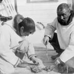 Hudson Strait Expedition. Two Inuit men preparing seal meat, Port Burwell, Nunavut / Expédition dans le détroit d'Hudson. Deux Inuits préparant de la viande de phoque, Port Burwell (Nunavut) thumbnail