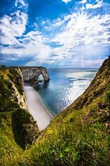 Secret Cove (PixStone) Tags: normandie etretat normandy france french cliff water ocean sea landscape cove nature arch sun colorful wildflowers beach spring clouds nikon d7100