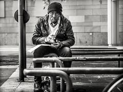 street.portrait (grizzleur) Tags: intenseeyecontact candideyecontact eyecontact eyes stare candidlook candid candidportrait candidphotography candidportraitphotography street streetphotography streetportrait streetcandid omd omdstreetphotography guy man dude blackman hat sit sitting seated olympusomdem10mkii olympusm45mmf18 bw mono monochrome olympus olympusstreetphotography