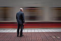 The Commuter (llabe) Tags: motionblur blur man lightrail commutertrain commuter urban downtown portland oregon nikon d750