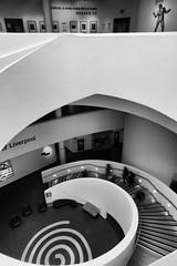 DSC00330-E-S.jpg (Mac'sPlace) Tags: mono museumofliverpool liverpool interior black white stairs spiral swirl people blur