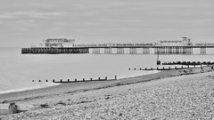 Worthing Pier from the Promenade (Stephen_Hartley) Tags: architecture beach coastline groyne monochrome pier sea seashore seaside southcoast westsussex worthing
