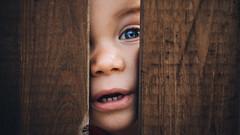 Hide and seek (RaulMaler) Tags: children child childhood eye smile portrait wood game hide seek playing funny blue