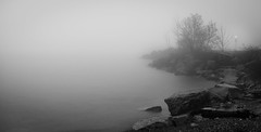 Guiding through fog (rmikulec) Tags: fog foggy rain thunderstorm storm no wind black white bw lkae lake shoreline lighthouse light
