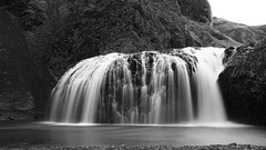 I will go where the wild river floes - HMM! (lunaryuna) Tags: iceland southiceland kirkjujabaerklaustur systrafoss waterfall mountainrange le longexposure river beauty nature textures blackwhite bw monochrome lunaryuna