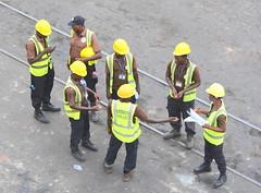 TOGO, WEST AFRICA:    YELLOW HARD HATS.  THE DOCKS OF LOME, TOGO,  AFRICA. (vermillion$baby) Tags: hardhats africa container done green lome people togo yellow ocean sea westafrica togosea port pier wharf dock wharves international world