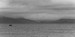 Lone ship - Dingle Beach (sundar_5050) Tags: sundar nikon 18105 dingle ireland kerry boat black white clouds beach
