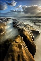 Sword and Shadows (TomGrubbe) Tags: lajolla hospitalbeach beach rocks sandiego clouds longexposure coast storm california seascape