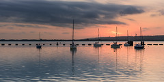 Dark Reflections (Explore 14-5-2017) (Sunset Snapper) Tags: darkreflections sunset langstoneharbour haylingisland hampshire southcoast uk boats yachts clouds reflection water seascape ripples filter lee nd grad nikon d810 2470mm april 2017 sunsetsnapper