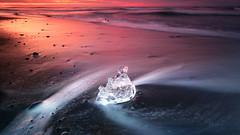 Diamonds ar not forever... (wolffslicht) Tags: jökullsarlon iveland iceberg ice lava beach waves sunset longtimeexposure stopper sea black