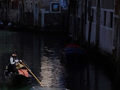 Finding a spot to check email (*CA*) Tags: italy venice canal gondola gondolier