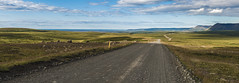 Icelandic gravel road (kewlscrn) Tags: island iceland remo bivetti nikon d800 2470mm f28 32mm f56 1125 iso50 travel panorama gravel road sea meer ocean dirt clouds hills mountains europe photography fotografie composition leading line gras