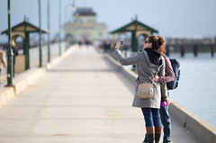 First to Know (Keith Midson) Tags: melbourne stkilda tourists people girl woman selfie photographer pier canon 200mm