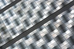 made of steel (Karl-Heinz Bitter) Tags: architektur deutschland leipzig architecture germany linien silver black diagonale waves wellen karlheinzbitter facade fassade einkaufscenter shopping mall