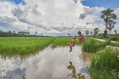 Countryside Children (Wandering Cambodia) Tags: children countryside jumping bath water sky cloud siem reap cambodia khmer landscape people lifestyle