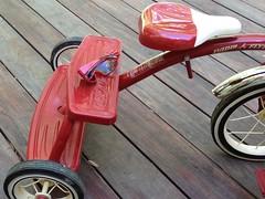(italartus) Tags: tricycle sunglasses play kid bike red