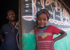Father and daiughter standing in front of a traditional painted house, Kembata, Alaba Kuito, Ethiopia (Eric Lafforgue) Tags: abyssinia africa alaba architecture art artwork building cheerful color culture decorated decoration depiction eastafrica ethiopia ethnic geometric girl halaba home horizontal hornofafrica house housing hut illustration kulito lookingatcamera man mural muslim outdoors painted painting portrait poverty residential ruralscene smile smiling teenager toukoul tukul twopeople village waistup ethio163422 alabakuito kembata