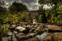 Bridged (Anthony P26) Tags: architecture category dartmoor dartsmeet devon england nonbuilding places travel stone stonework stonebridge landscape landscapephotography travelphotography canon canon70d canon1585mm sky cloudysky greyclouds clouds river riverbank trees rocks stones water reflections outdoor