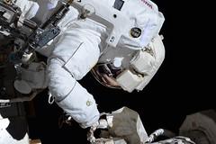 Not easy with big pressurized gloves (Thomas Pesquet) Tags: spacewalk eva jackfischer peggywhitson iss internationalspacestation