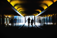 The light at the end of the tunnel... (The Ultimate Photographer) Tags: london uk england towerbridge tower bridge tunnel dark light yellow blue walking shadow twomen reflection lighting urban streetphotography olympus omd em1 ultimatephotographer underground lunchtime friday bags bag abstract sunglasses