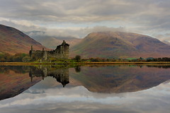 Silent reflection by images@twiston - Silent reflection - The beautiful ruins of Kilchurn Castle reflected in the perfect mirror like surface of Loch Awe on a still and silent day.  Although relatively overcast with pockets of sunlight just sneaking through the cloud, the super still reflections made for a sight to behold at this incredible and quintessentially Scottish location; a time for quiet contemplation and for silent reflection marvelling first hand at nature's raw beauty.   Dalmally, Argyll and Bute, Scotland  | My website |