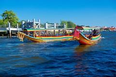 Longtail or Dragon boats on the Chao Phraya river in Bangkok, Thailand (UweBKK (α 77 on )) Tags: long tail longtail dragon boat river chao phraya water flow sky blue transport bangkok thailand southeast asia sony alpha 77 slt dslr