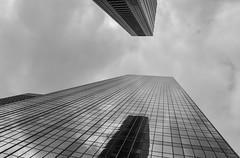 Fear & Trembling (Brinkervelt.) Tags: downtown building architecture glass reflection foreboding clouds bw blackandwhite blackwhite cmwd cmwdblackandwhite