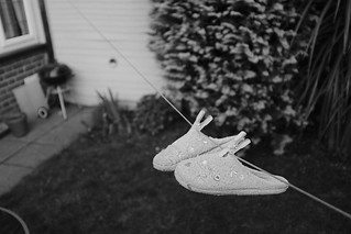 127/365 Drying Slippers #project365 #fujifeed365 #hanging #slippers #washingline #drying #household @sezzybee #fuji #fujix100f #x100f #acros #bw #blackandwhitephotography #blackandwhite #garden #senseofdepth