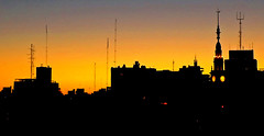 The Silhouette of the City at Sunset (mariagrandi985) Tags: city cityskape citycenter sunset sunsetlight ilovesunset sunsetoverthecity buildings tower towerclock oldtower buildingwithtower orange orangeandyellow yellow black silhouette silhouettes contrast contraluz highcontrast rosarioargentina composition perfectcomposition mariagrandi985 atardecer atardecerenlaciudad awardtree lanoche