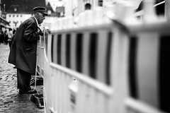 Stands with a fist (AlphaAndi) Tags: monochrome menschen mono menschenbilder urban trier tiefenschärfe deepoffield dof fullframe face vollformat city closeup blackandwhite blackwhite bw bokeh bokehlicious sony streetshots schwarzweis street streetshooting streets streetportrait sw sonya7ii streetphotographie strase strasenleben streetlife
