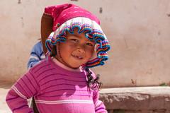 Peruvian Portrait, Isla Taquile (Geraint Rowland Photography) Tags: crop portrait peruvianportrait childportrait pink colourful dress peruviancostume cropped islataquile laketiticaca puno peru southamerica geraintrowlandphotography imagesbygeraintrowland moreimagesatwwwgeraintrowlandcouk travel travelperu latamperu visitperu promperu