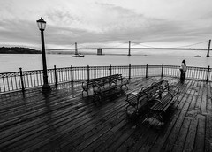 Lost in thoughts (Rabican7) Tags: sanfrancisco california pier monochrome bw view melancholy benches streetlamps bridge thoughts sea seascape bay floor