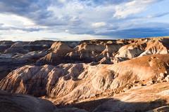 Painted Desert (bj.geske) Tags: desert painteddesert navajonation arizona colorful landscape nature clouds sunset blue red brown americansouthwest shadows badlands erosion siltstone mudstone shale stratified
