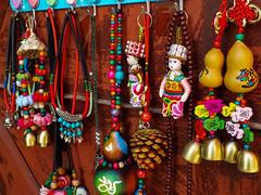 Souvenirs (Romane Licour) Tags: tibetan chinese bai tradition yunnan yuanyang china souvenir bells necklace bracelet colors pine